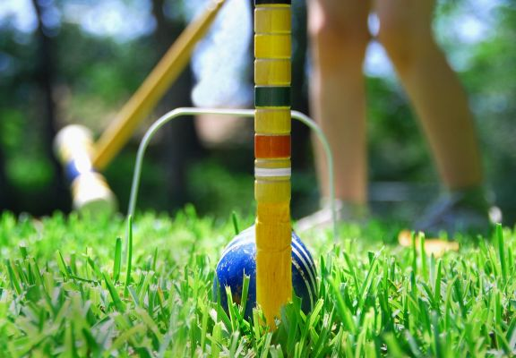 Playing Croquet on Lawn